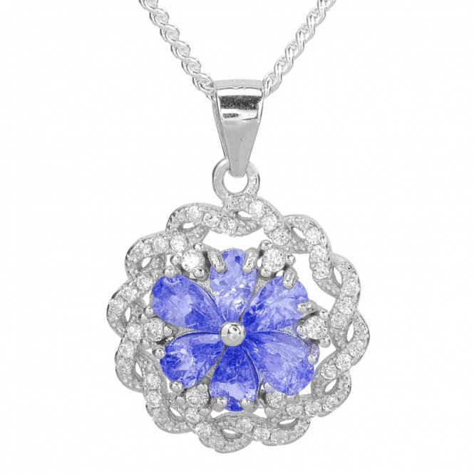 Shipton and Co 2½cts of Tanzanite Haloed by White Topaz