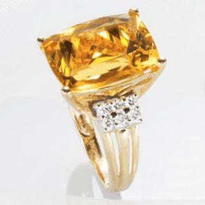 9.25ct Golden Beryl in an Elevation of Diamonds