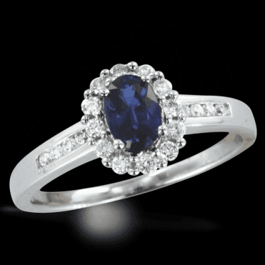 Sapphire Ring Lit By Twenty Diamonds Totalling a Quarter of a Carat