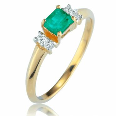 1/2ct Octagon Cut Emerald Ring lit by Fine Diamonds