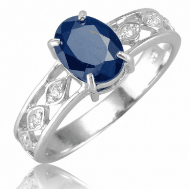 1½cts of Deep Blue Sapphire Lit by White Topaz