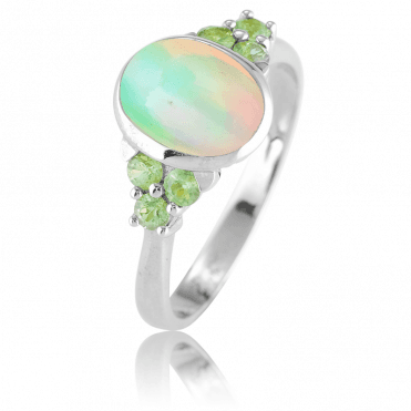 Iridescent Opal Lit by Green Sapphires