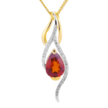 3ct Pear of Hessonite Garnet set with Gold & Diamonds